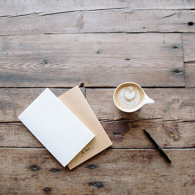 content marketing coffee cup and writing pad