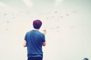 Man working on whiteboard