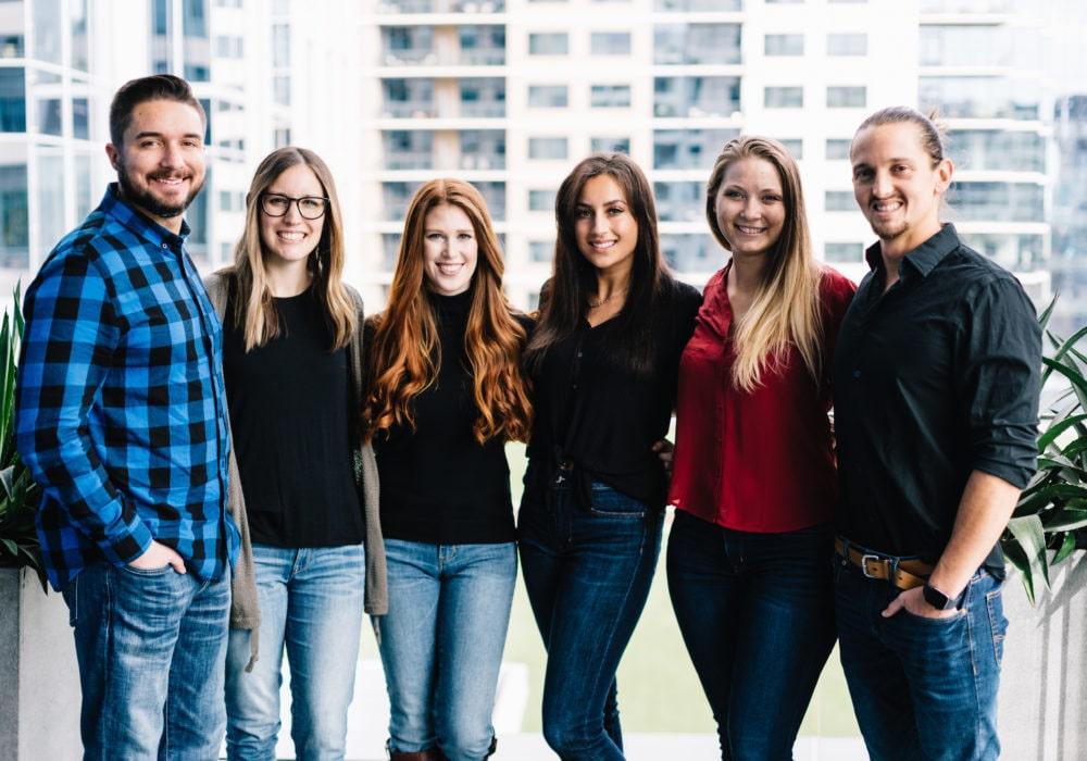 JSL Marketing Team members smiling enjoying fun company culture 2