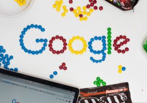 Google spelled out in candy on a desk