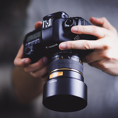 DSLR Camera in hands of photographer